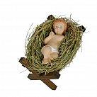 Dzieciątko Jezusek na sianku w drewnianym żłóbku